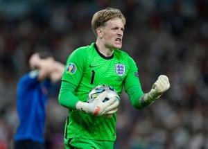 England's Jordan Pickford celebrates saving from Italy's Jorginho during a penalty shootout.