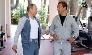 Putin and Medvedev at gym