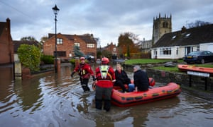 Emergency services rescue residents in Fishlake, South Yorkshire, after the village was flooded