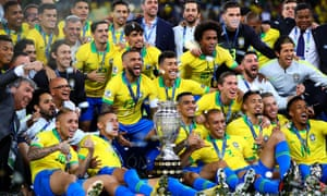 Brazil celebrate with the trophy following the Copa América final against Peru.