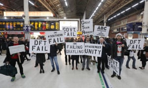 Commuters protest at Victoria station about the disruption on Southern Rail