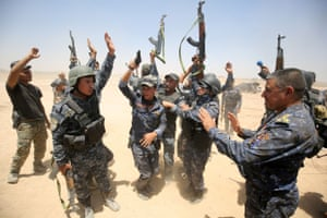 Pro-government forces fighters celebrate in al-Sejar village as they take part in a major assault to retake the city of Fallujah.