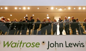 John Lewis and Waitrose employees wait for the announcement of their 2016 results linked bonus at their flagship store in central London.