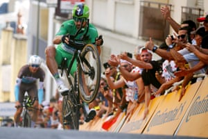 Peter Sagan of Team Bora-Hansgrohe, wearing the Green Sprint wheelies as he crosses the finish line during the thirteenth stage, an individual time trial over 27.2 kilometers with start and finish in Pau.