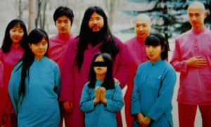 An undated photo shows cult leader Shoko Asahara (C, back) with his wife Tomoko (L, front) and daughter Archery (C, front) along with inner group of disciples