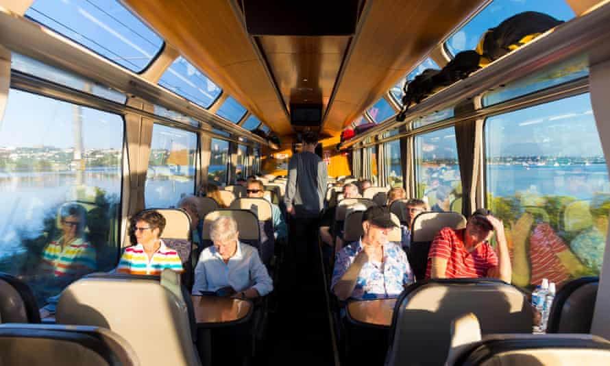 People sitting inside the scenic Northern Explorer train going between Auckland and Wellington,