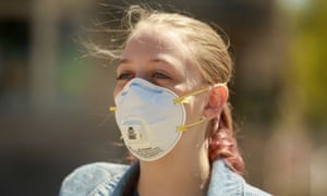A woman wears an N95 repirator mask in Indiana on 22 April.