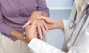 Rheumatoid arthritis, general practitioner examining patient's hands