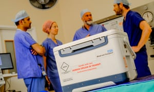 An NHS organ donation box arrives at hospital for a transplant operation.
