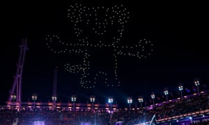 "Drones light up the sky in the shape of the Pyeongchang Winter Olympic Games mascot, a white tiger named ""Soohorang"" during the closing ceremony of the Pyeongchang 2018 Winter Olympic Games at the Pyeongchang Stadium on February 25, 2018. / AFP PHOTO / Martin BERNETTIMARTIN BERNETTI/AFP/Getty Images"