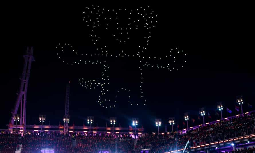 """Drones light up the sky in the shape of the Pyeongchang Winter Olympic Games mascot, a white tiger named """"Soohorang"""" during the closing ceremony of the Pyeongchang 2018 Winter Olympic Games at the Pyeongchang Stadium on February 25, 2018. / AFP PHOTO / Martin BERNETTIMARTIN BERNETTI/AFP/Getty Images"""