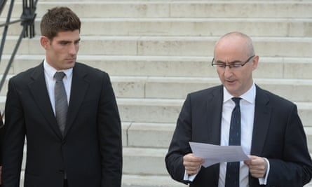 Ched Evans outside court as his lawyer reads out a statement following the not guilty verdict in his retrial.
