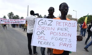 Protesters hold banners calling for greater transparency in the oil industry at a march in Dakar, Senegal.