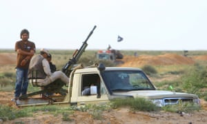 Heavily armed vehicles belonging to rebels involved in fighting near the city