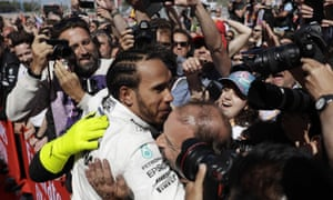 Mercedes driver Lewis Hamilton celebrates with his Mercedes team after winning in Barcelona.