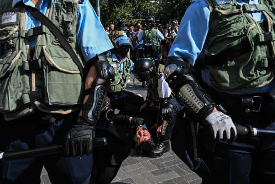 Riot police arrest a protester in the Wong Tai Sin district of Hong Kong