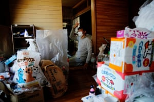 A room in Kato's home is filled with pet supplies for cats and dogs