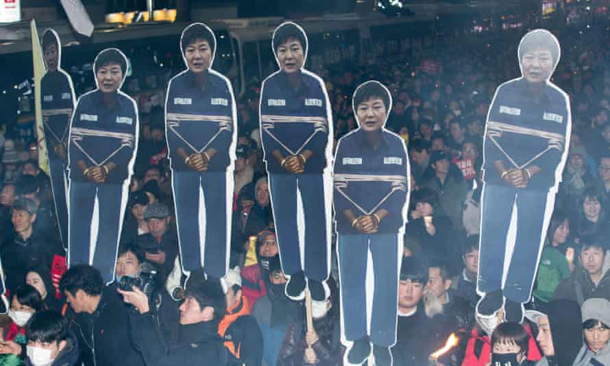 Protesters call for Park Geun-hye to step down in Seoul.