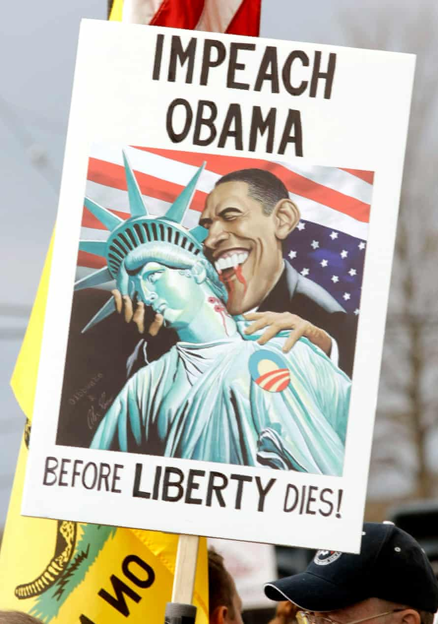 A Tea Party supporter holds an anti-Obama sign at a rally in Clinton Township, Michigan, in April 2010.