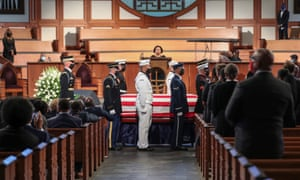 The casket is prepared for movement at the end of a funeral service for John Lewis in Atlanta, Georgia, on 30 July.