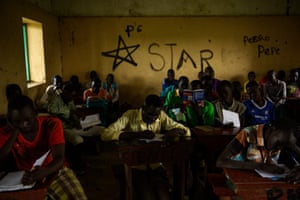 Pupils copy notes from a blackboard at the Pibor boys' school.