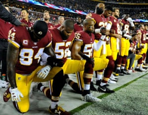 Washington Redskins tight end Niles Paul, Ryan Anderson, and Chris Carter kneel with teammates during the national anthem before the game against the Oakland Raiders at FedEx Field.