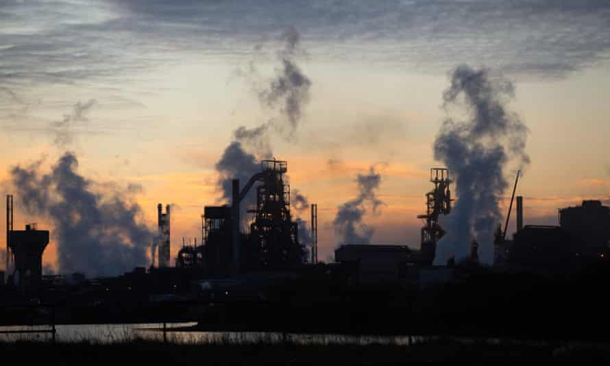 The sun rises behind the Tata steelworks in Port Talbot, south Wales.
