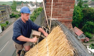 Thatching the roof of a Somerset cottage.