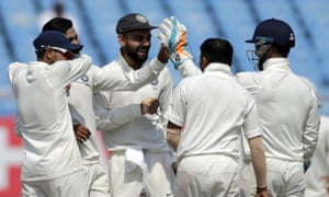 Virat Kohli celebrates with his India teammates after the dismissal of West Indies' Keemo Paul.