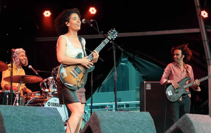 Supremely talented jazz vocalist Julia Biel and band smile and play on as strong winds force open the back curtains and blow across the stage at the Canary Wharf Jazz Festival, London 20 August 2016.
