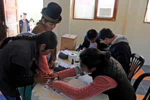 An Aymara woman casts her vote during presidential elections, after polls opened in Bolivia