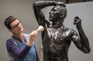 A conservator from the British Museum wors on The Age of Bronze by Auguste Rodin (1877).
