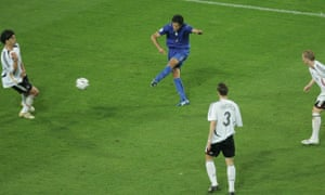 Fabio Grosso fires the ball past Michael Ballack and into the net, breaking the deadlock in the last minute of extra time