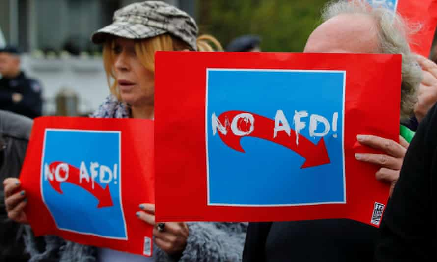 Protesters hold placards to demonstrate against the AfD during its election campaign launch in Essen, North Rhine-Westphalia.