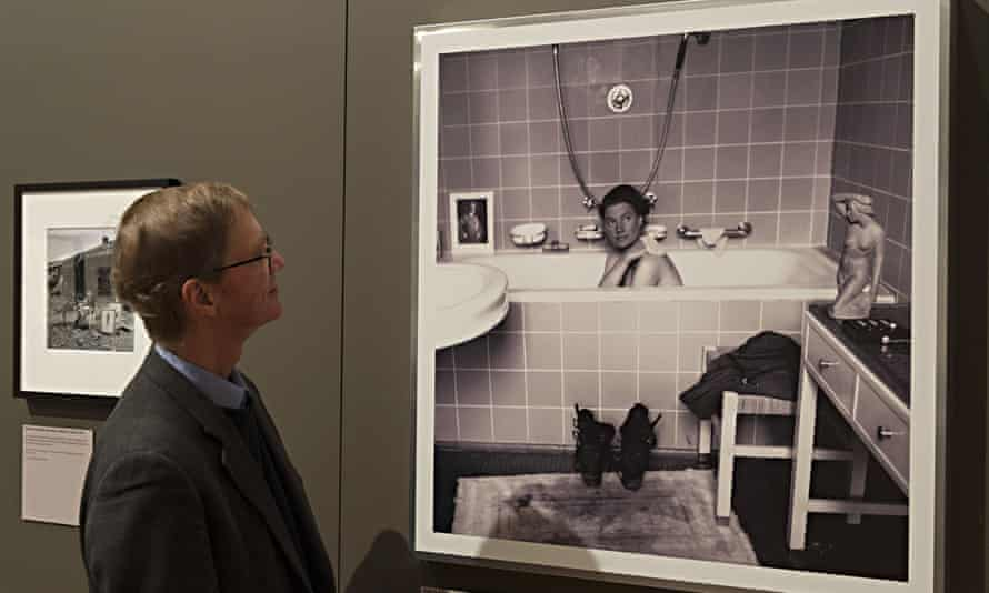 Penrose viewing famous photograph of his mother in Hitler's bath