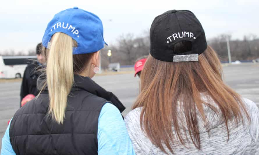 Brandi Tillman, 25, and Stephanie Friess, 24, display their homemade 'Adorable Deplorable' hats on the way to Trump's inauguration.