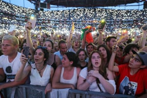 Fans cheer the singer Ed Sheeran during a performance in Lisbon, Portugal