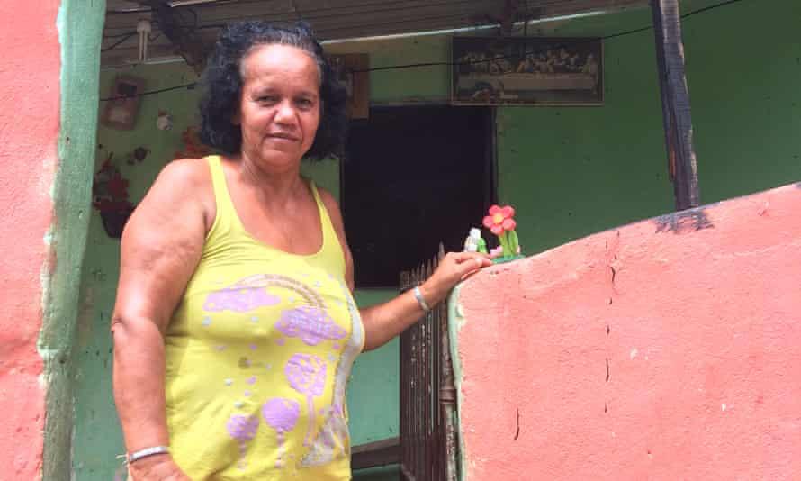 Marli Amara outside her home in Linha do Tiro.