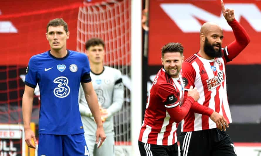 Sheffield United's David McGoldrick (right) celebrates with teammate Ollie Norwood after scoring his team's first goal in their 3-0 win over Chelsea.