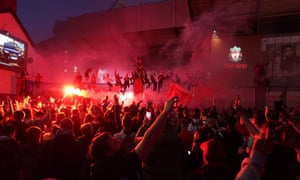 Liverpool supporters react outside Anfield stadium.