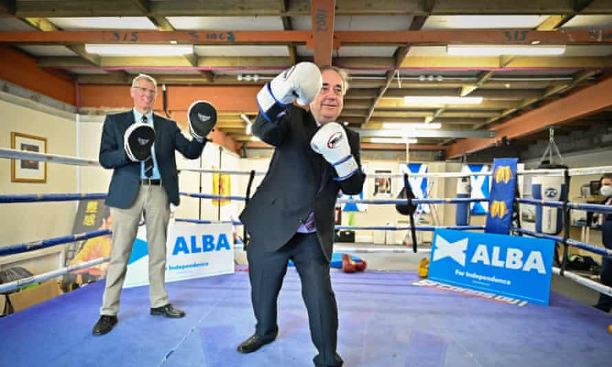 Alex Salmond working out in a boxing ring with boxing gloves on as part of a campaign event