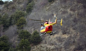 A helicopter of the French civil security services flies near Seyne