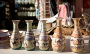 Bottles filled with coloured sand for sale, Jordan