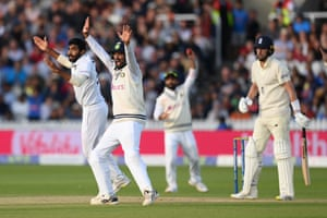 Jasprit Bumrah (L) and Cheteshwar Pujara of India appeal for lbw against Ollie Robinson.