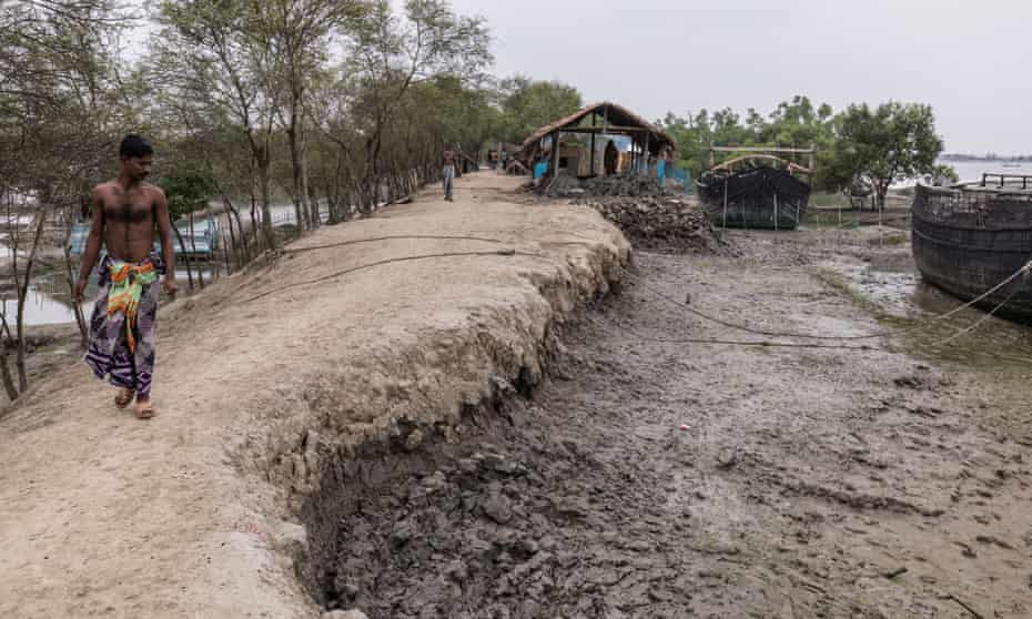 With every high tide, the embankments that protect villages and farmland around Shymnagar in southern Bangladesh are further eroded