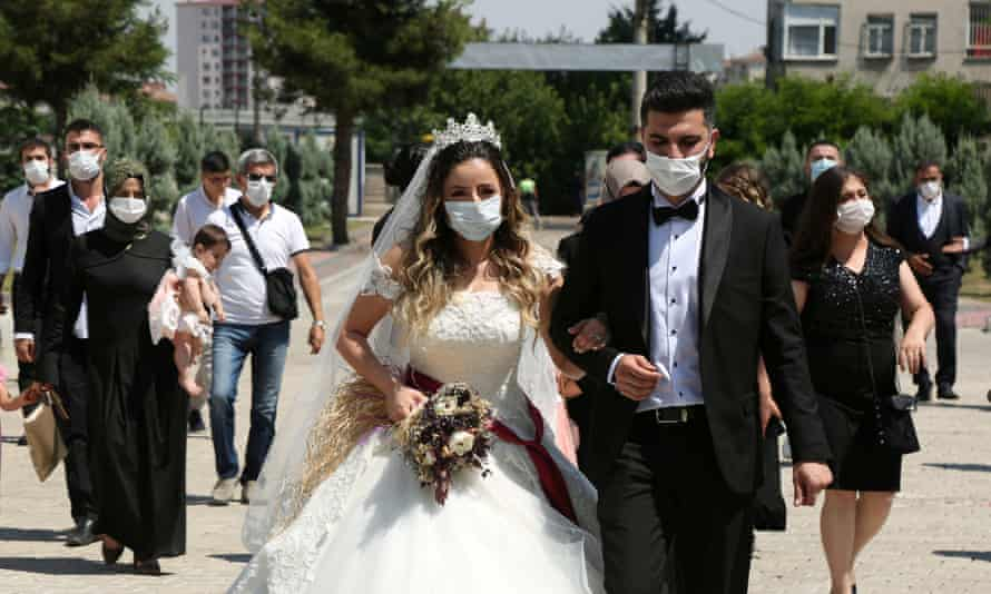 A couple in Diyarbakır, Turkey, after their civil wedding ceremony, held before new restrictions came in on 4 September.