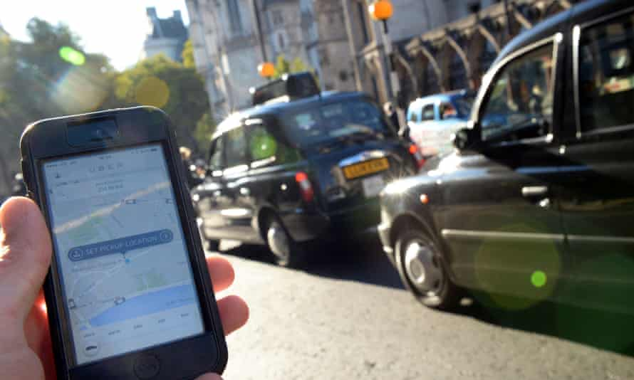 A man awaits an Uber driver in central London.