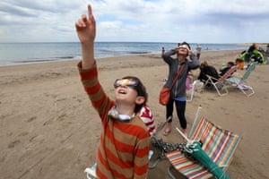 Las Grutas, ArgentinaPeople observe the solar eclipse over South America, visible in parts of Chile and Argentina