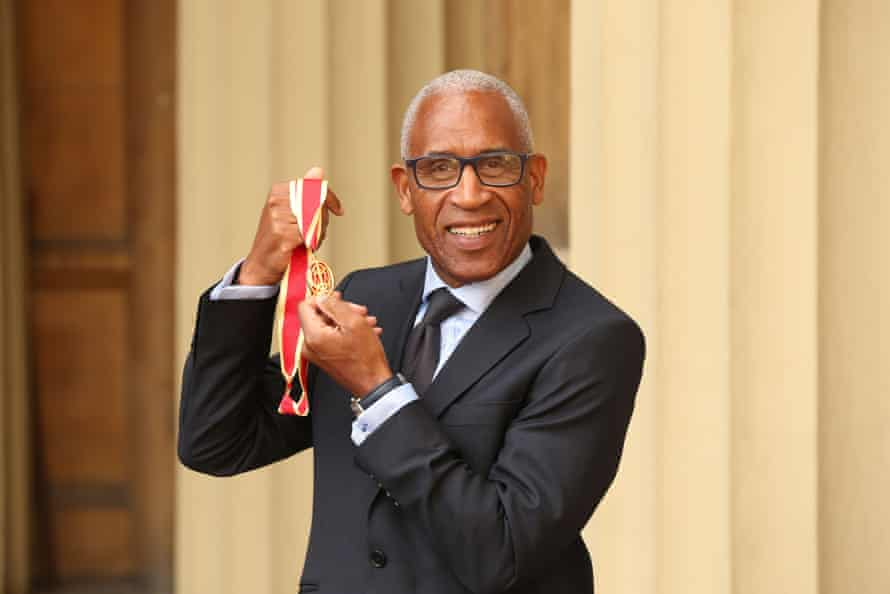 Woolley with his medal after being appointed a knights bachelor at Buckingham palace in 2019.