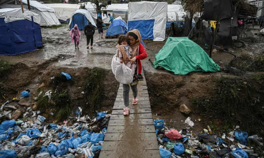 Woman with child in moria camp